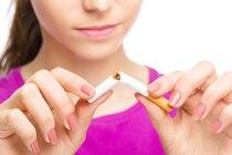 Woman breaking a cigarette in half