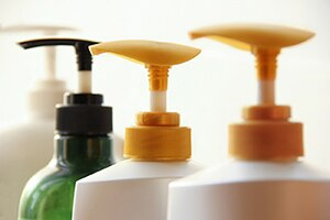 A picture of several bottles of lotion.