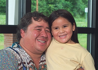 An American Indian man and young girl.
