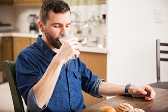 Man drinking a glass of milk.