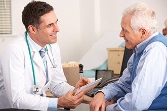 Health care professional speaking with a patient and sharing a document