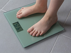 A person standing on a scale.