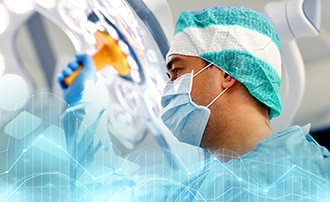A surgeon adjusting a light in the operating room.