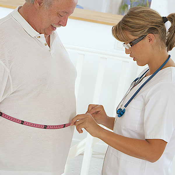 doctor examining an obese patient