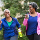 Two African American women walking together for exercise