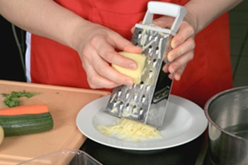Person grating potatoes.