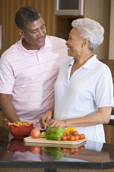 A photo of an older couple making a heart-healthy meal.