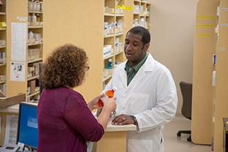 A patient talking with her pharmacist.