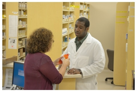 Woman talking with pharmacist.