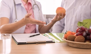 A dietitian discusses healthy eating habits and how to plan meals with a patient.