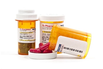 Labeled prescription medicine bottles.