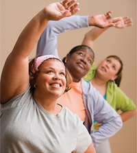 Women stretching to the right at a workout class