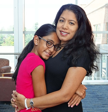 A photo of Radhika and her daughter