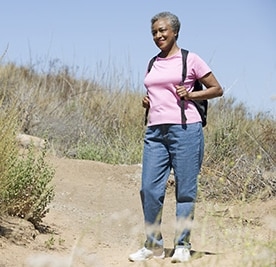 A woman exercising through hiking