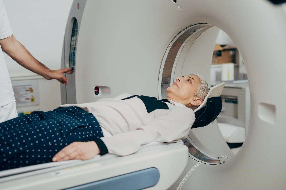 A patient coming out of a CT scan.