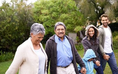 Family walking through a park.