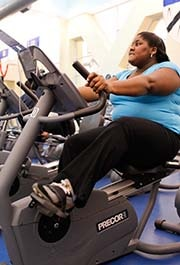 A woman exercising on a recumbent bike
