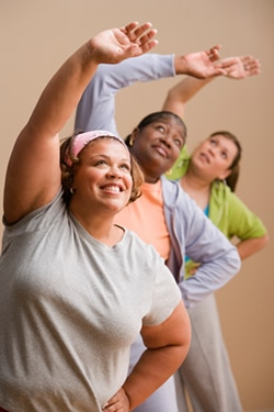 Women stretching in a fitness class.