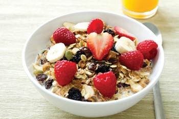Photo of a bowl of cereal with fresh strawberries
