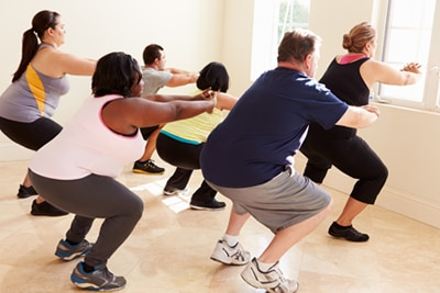 Group of men and women in an exercise class