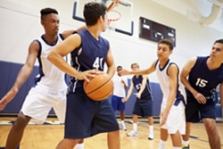 Photo of boys playing basketball