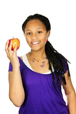 Photo of girl holding a red apple