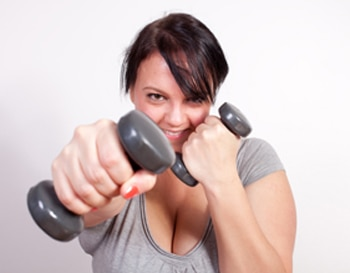 A woman using hand weights