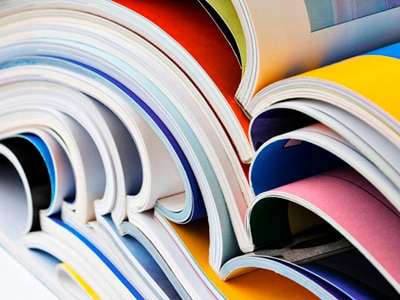 abstract image of books open and stacked on top of one another