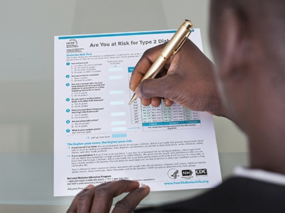 A man filling out the Diabetes Risk Test