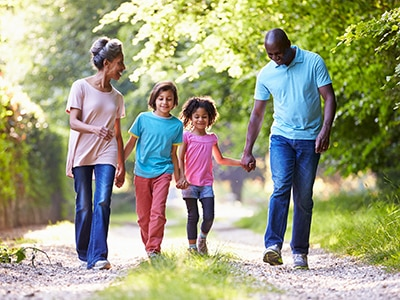 A family outside walking together