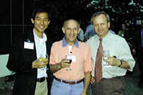 Photo of Alex Chang (Ph.D., 1998) and Jan Hirsh (Ph.D., 1977) with Paul