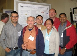 Photo of team in front of poster at the 2009 Gordon Research Conference