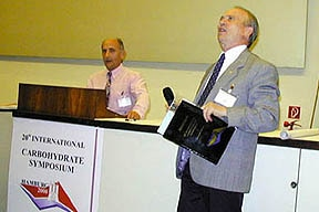 Photo of Dr. A. Liptak introducing Paul's presentation at the 20th International Carbohydrate Symposium