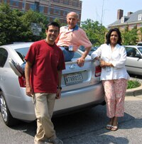 Group photo on car with licence plate reading NTHROSE