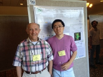 Photo of Pang and Paul showing their poster presented at 2013 Gordon Conference on Carbohydrates
