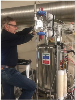 Image of Dr. Adriaan Bax working with an NMR Spectrometer in his lab
