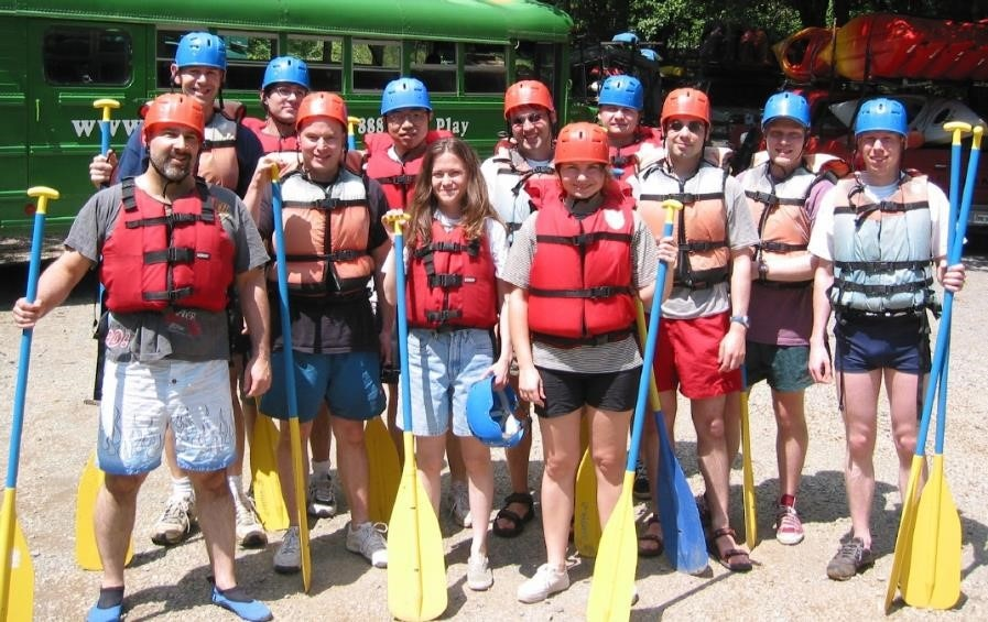 Group photo of the bax group wearing rafting gear
