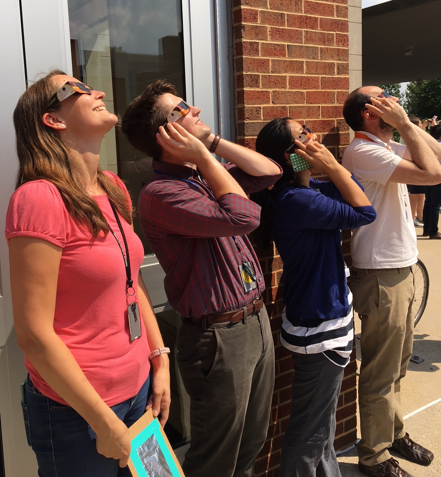 A photograph of people looking at a solar eclipse