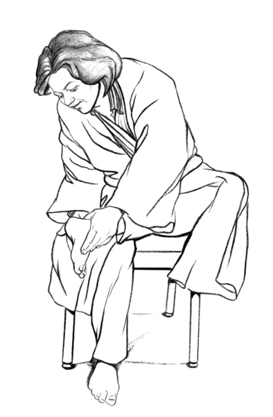 Drawing of a woman dressed in a bathrobe sitting in a chair and checking the bottom of her left foot.