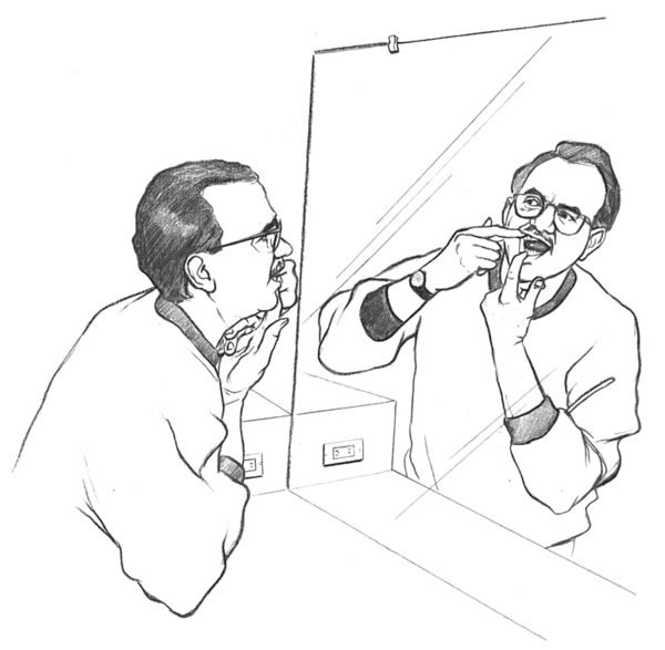 Drawing of a man holding his mouth open with his fingers and looking in a mirror to check his teeth and gums for signs of problems.