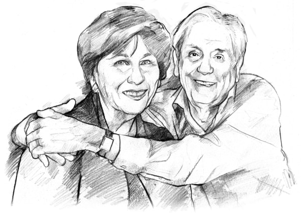 A smiling older woman and man. The man has his arms around the woman's shoulders.