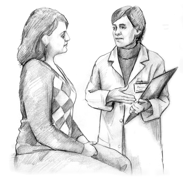 A female doctor talking with a female patient.