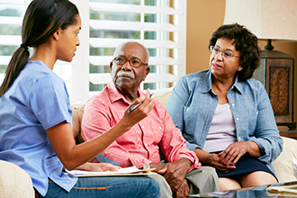 Couple meets with health care provider in their home.